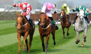 Jockeys battle it out in the closing stages of a race at the Grand National meeting.
