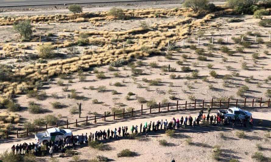 Migrants, apprehended after illegally crossing along the US-Mexico border in Arizona are lined up. Scott Daniel Warren faced charges for providing migrants with water, food and lodging.