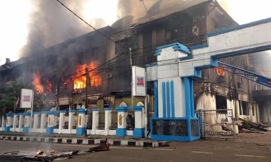 A local parliament building burns during a protest in Manokwari