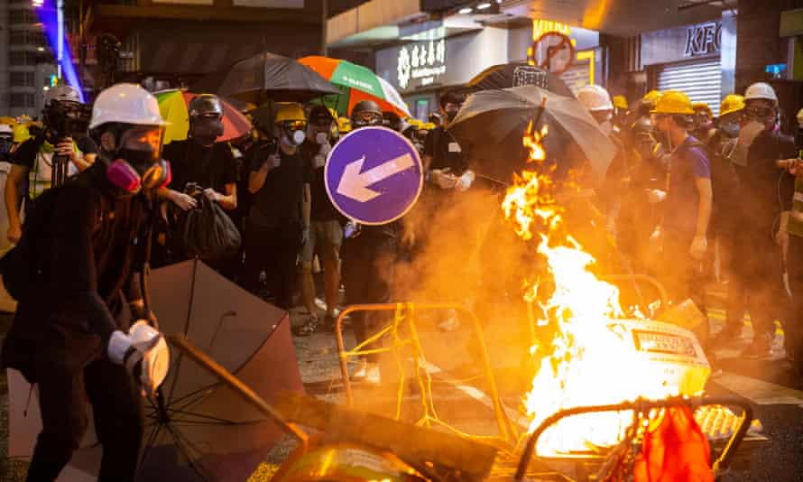 Protesters light a fire during a rally in Causeway Bay