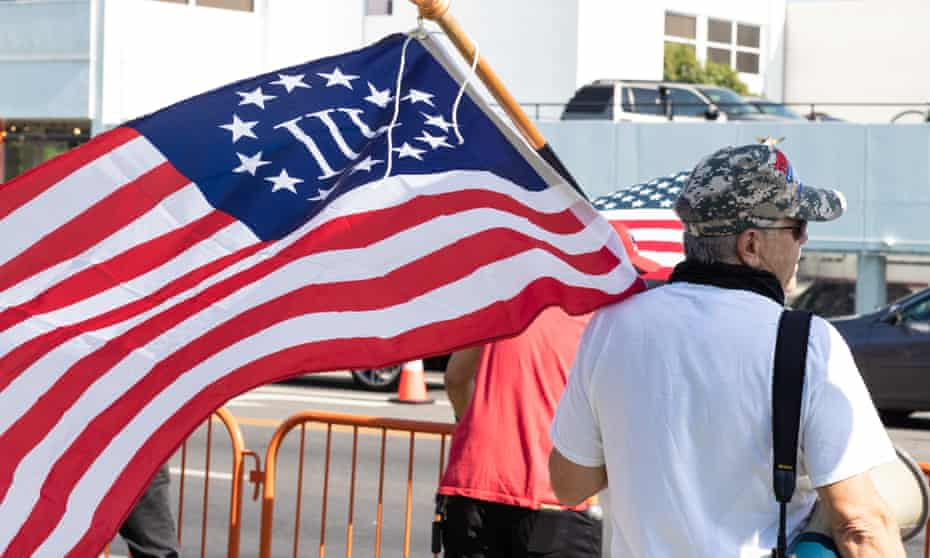 A Three Percenter protester attends a Maga and QAnon Rally in Los Angeles on 3 October 2020.