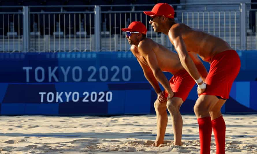 Spanish beach volleyball players practice in Shiokaze park in Tokyo. Staff have had to hose down the hot sand.