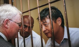 A file picture dated 8 October 2010 of Andrew Chan (R) and Myuran Sukumaran (C) talking to their lawyer from inside a holding cell at Denpasar district court.