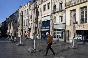 A man walks past closed restaurants in Montpellier, southern France, on 8 March, 2021, amid the Covid-19 pandemic.
