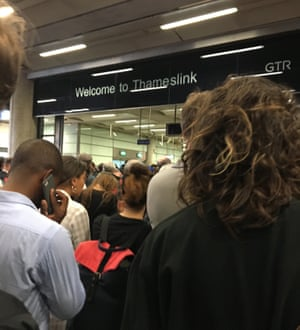 Passengers waiting to access Thameslink services at London St Pancras International station.