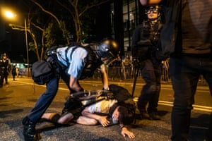 A protester is detained
