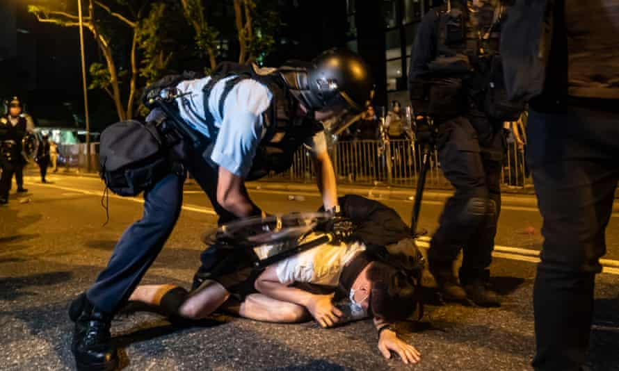 A protester is detained during a clash after a rally against the extradition law on Sunday.