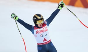 Millie Knight celebrates after her run in the women's downhill for visually impaired competitors.