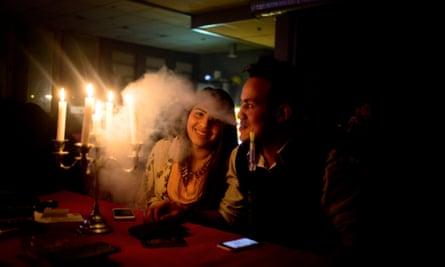 A brother and sister share a shisha pipe at Nahawand Shisha