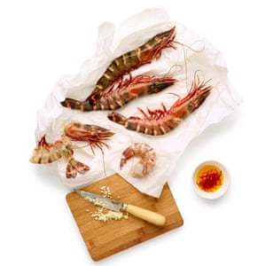 1 First make a prawn stock: sweat chopped garlic in oil, then fry the prawn shells before adding fish stock.