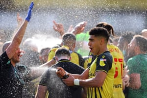 Adam Masina of Watford sprays champagne at the final whistle.