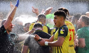 Adam Masina cracks open the bubbly as Watford head back to the top flight.