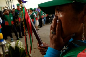 A member of the Indigenous Guard of the Kokonuko people attends the funeral of journalist Efigenia Vasquez in Aguas Tibias, Coconuco, Cauca. They say she was killed by police to intimidate them.