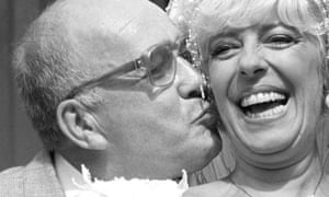 Bet Lynch (Julie Goodyear) getting a kiss from television groom Alec Gilroy (Roy Barraclough) in an episode of Coronation Street, 1987.