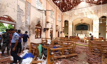 Sri Lankan officials inspect St Sebastian's church in Negombo, north of Colombo, after a suicide bombing.