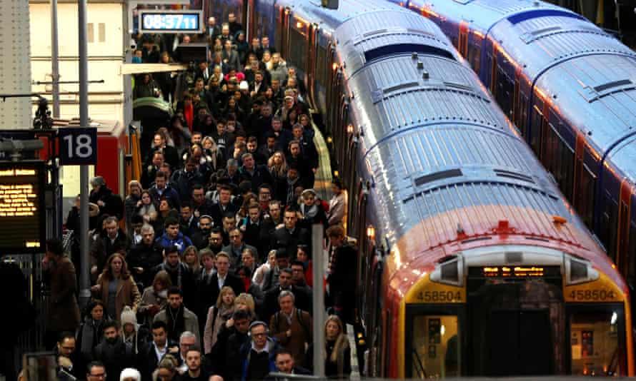 Passengers on a platform at Waterloo station