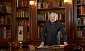 Pierre Bergé in his library