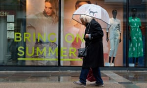 A summer-themed shop window display in Worcester, as wet and windy weather covers much of the region.