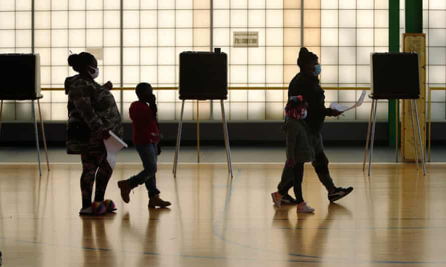 Voters cast their ballots in Cleveland on 3 November.