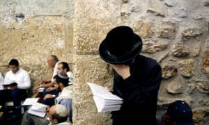 Worshippers at the Western Wall in Jerusalem's Old City on Tisha B'Av, which commemorates when the Second Temple was destroyed.