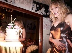 Kylie Minogue, eyeing up cake adorned with big 50, enjoys her 50th birthday party