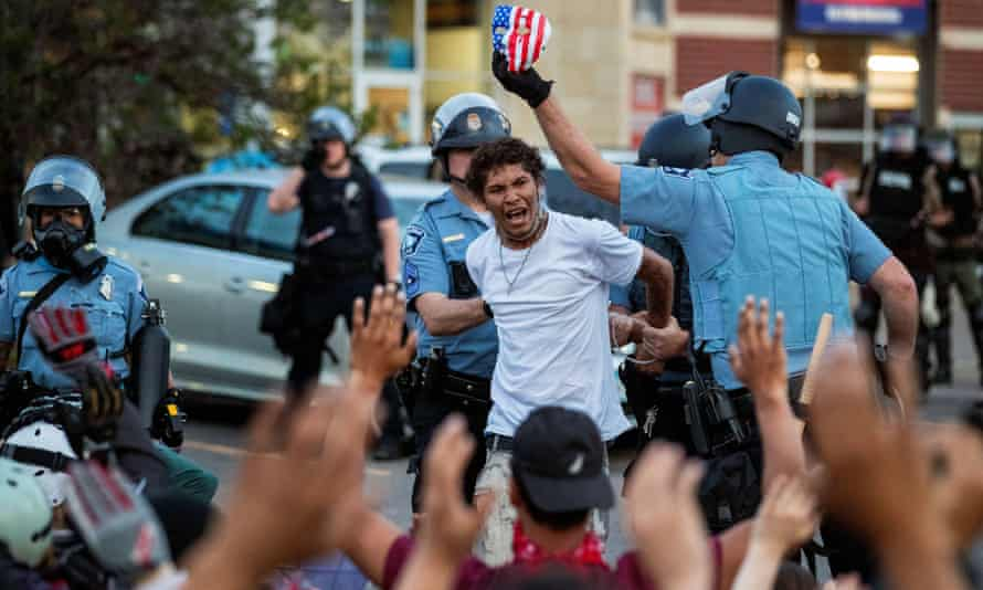 Minneapolis police detain a man during protests over the death of George Floyd. The Minneapolis council president said efforts to reform the police department have not been successful.