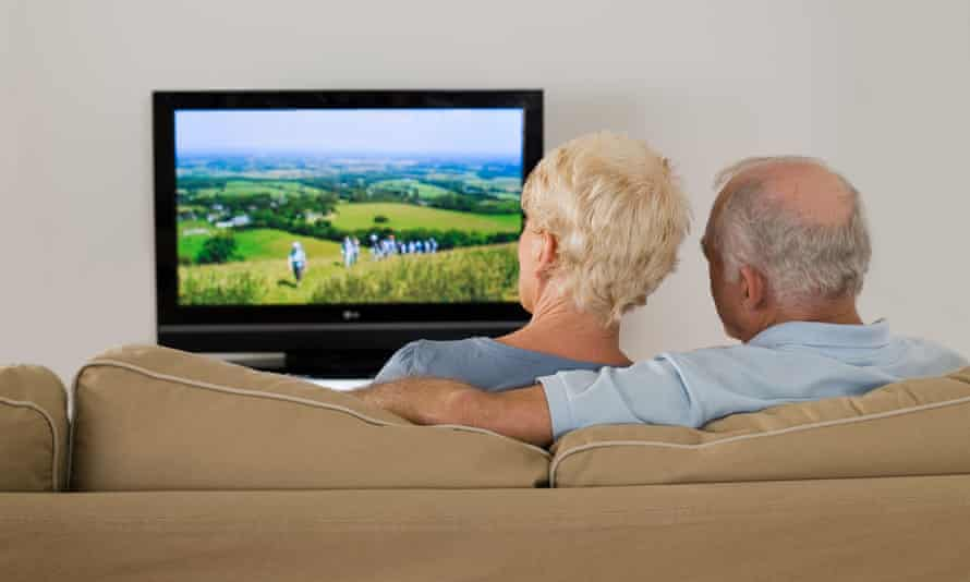 An older couple watching TV