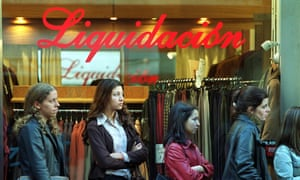 """Women line up for a job interview at a Buenos Aires store promoting """"liquidacion', or sale, amid Argentina's default crisis of 2001."""
