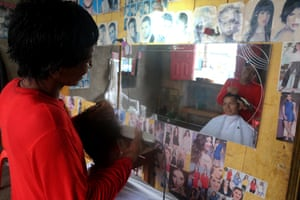HIV patient José Roca in his hair salon in Tamshiyacu.
