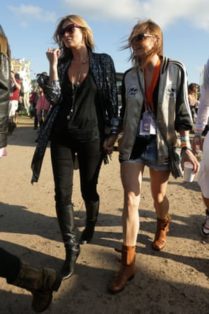Glastonbury style stalwarts: Stella McCartney and Kate Moss wearing classic AAA outfits, in 2013.