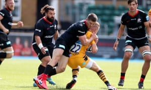 Saracens' Owen Farrell hits Charlie Atkinson high and is sent off in the second half against Wasps.