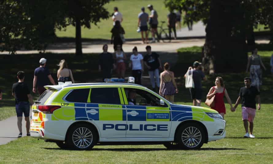 Police officers in a patrol car in Greenwich Park, London