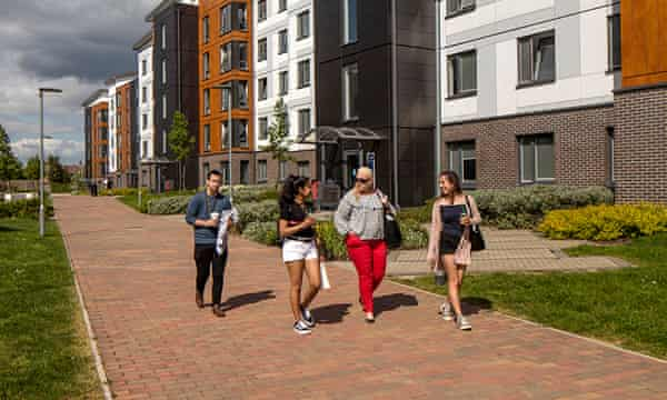 College lane accommodation with a group of students walking past.