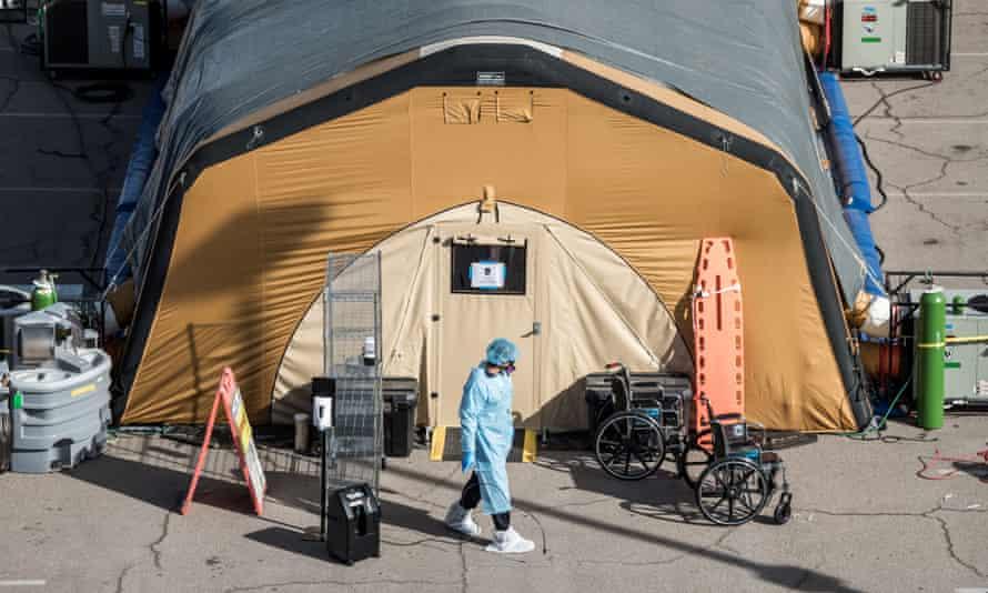 A nurse exits a tent for coronavirus patients at University Medical Center in El Paso, Texas.