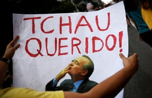 """A protester holds a sign that reads """"Bye Darling"""" to Renan Calheiros, during an anti-corruption demonstration in São Paulo."""