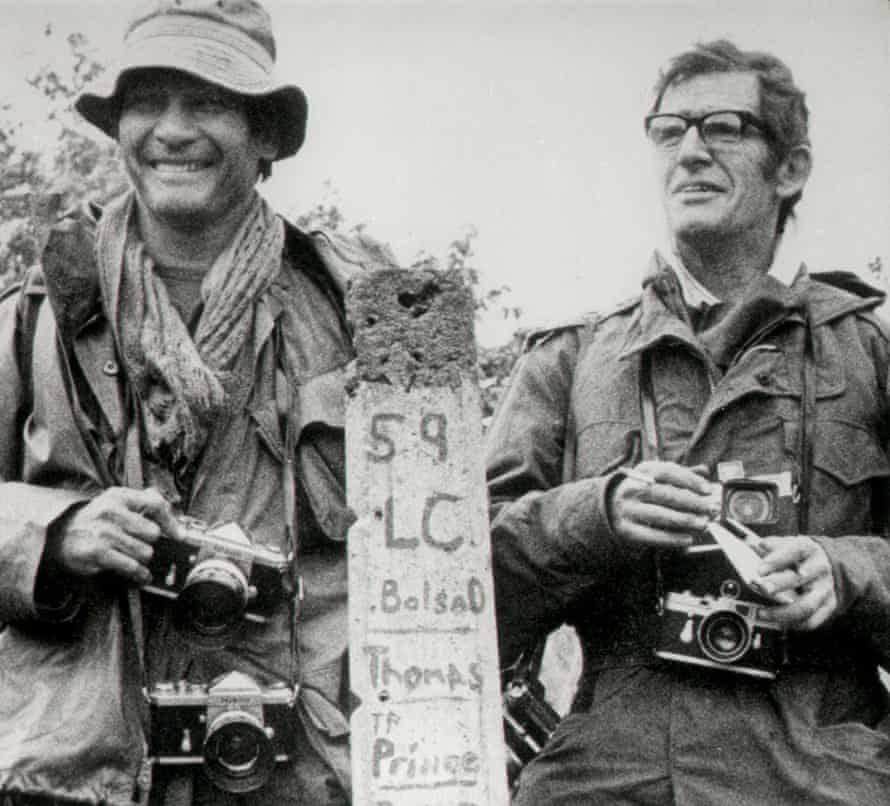 AP photographer Henri Huet, left, and Life magazine's Larry Burrows are seen in February 1971 at the Vietnam-Laos border near Ben Het. They were killed along with two others when the helicopter they were in was shot down a few days later.
