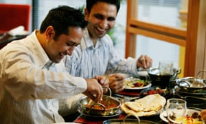 Two men enjoying a balti meal at a restaurant in Ladypool Road in Birmingham
