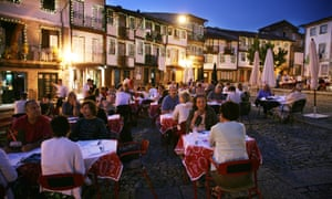 Holidaymakers eat out in the main square , Guimaraes, Portugal