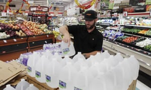Chris Creel, manager of Piggly Wiggly, stocks pallets of bottled water as grocery customers prepare for the arrival of storm weather with Hurricane Dorian in New Bern, North Carolina.