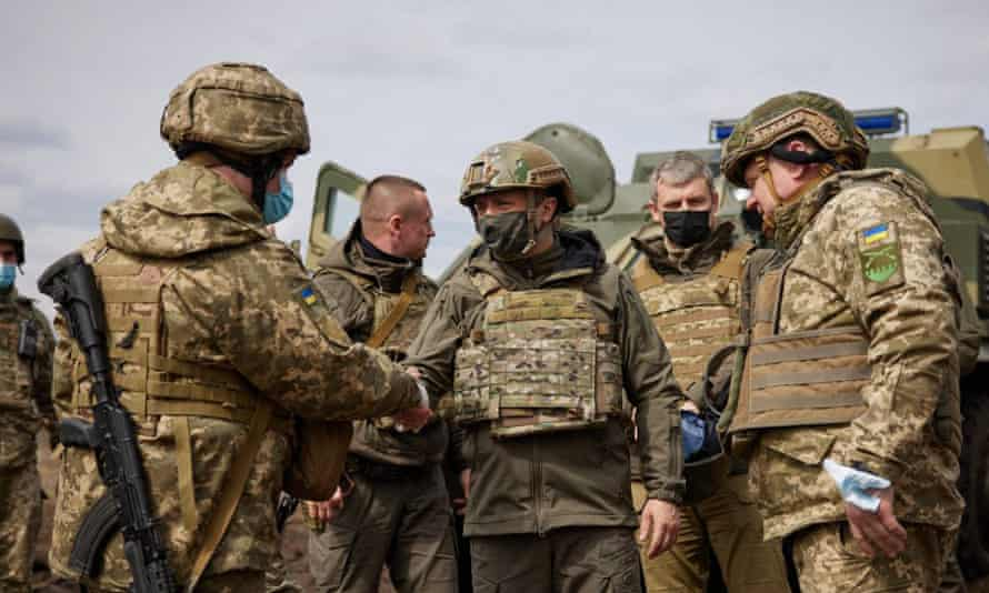 Ukrainian president Volodymyr Zelenskiy visited the frontlines on Thursday, saying: 'I want to be with our soldiers in the tough times in Donbas'
