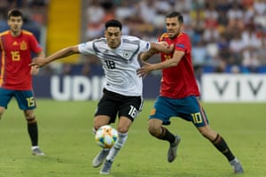 Nadiem Amiri of Germany and Dani Ceballos of Spain battle for the ball.