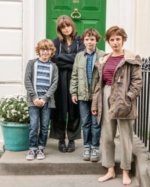 The television adaptation of Love, Nina with Helena Bonham Carter as Georgia (Mary-Kay Wilmers), her two sons, and Faye Marsay as Nina, right.