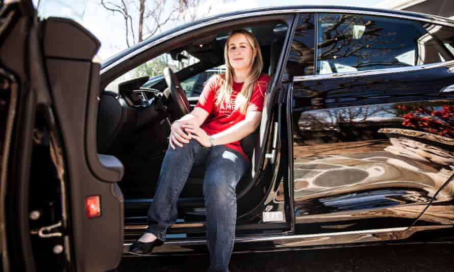 AJ Vandermeyden sits in her Tesla outside her family's home in San Carlos, California. 'Unless someone stands up, nothing will change.'