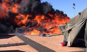 Refugees' tents set alight at RAF Dhekelia, a British sovereign base in Cyprus. The UN says Britain should resettle the migrants but MoD says it 'will not allow a new migrant route to open up to the UK'.