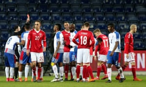 Panama's Blas Perez is sent off by the Irish referee Neil Doyle for a foul on Kasper Schmeichel in their 1-0 loss in Denmark.