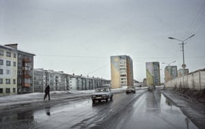 Vorkuta Ring Road. Russia. 2009 Most of the roads all around Vorkuta, seems like a ghost town instead of the bigger and one of the most riches cities of the russian north during the Soviet Union times. Due to the isolation and the hard conditions in where they live, there is a high rate of depression between it's inhabitants, so during the long, white and cold winters, they paint the building with colors. By doing it, they give to the city a better look. Also, during the snow storms that suddenly hit the city, this colors become the visual reference to go back home