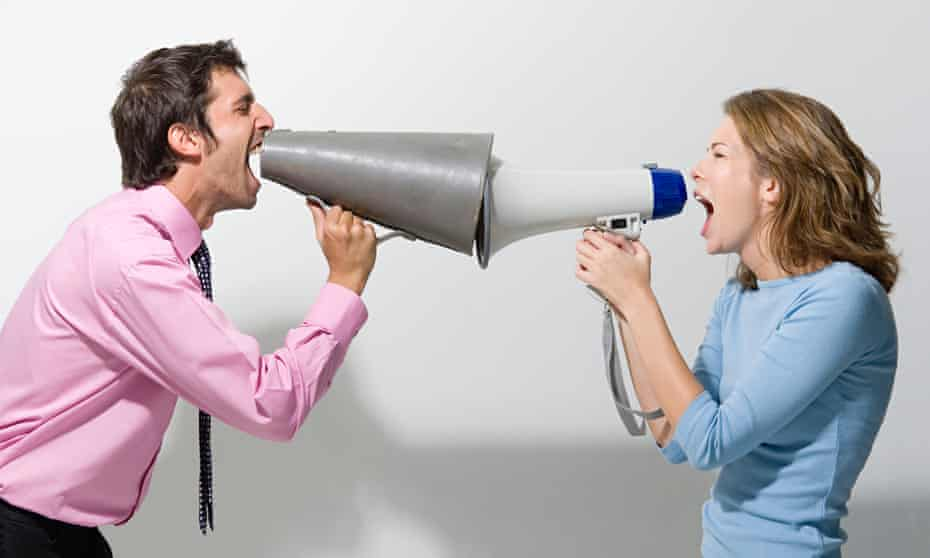 Man and woman shouting at each other through megaphones