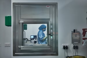 A bio-technologist inside a cell suite at Oxford Biomedica