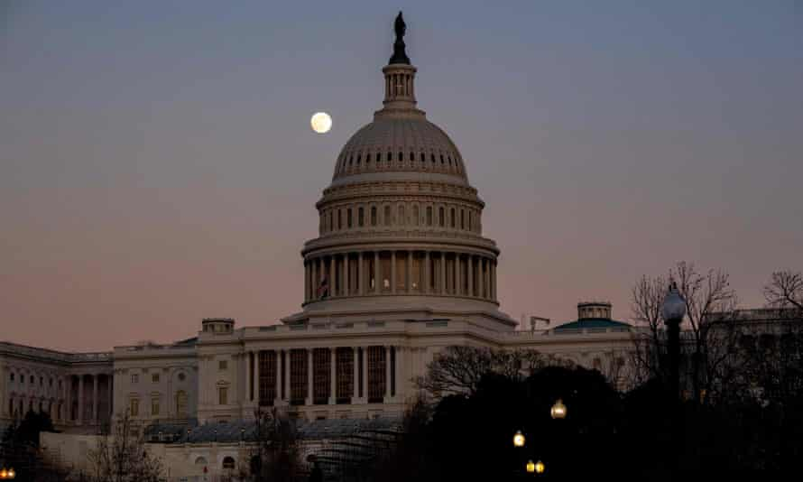US-POLITICS-CONGRESS-TRUMP-VETO<br>The moon rises over the US Capitol Dome at sunset in Washington, DC, December 28, 2020. - The US House of Representatives dealt a blow to President Donald Trump on December 28 by rejecting his veto of a defense bill, setting the stage for the Senate to deliver the first veto override of his presidency. The Democratic-controlled House voted 322 to 87 to override Trump's veto of the $740.5 billion bill, with 109 members of the president's own party siding with Democrats. (Photo by SAUL LOEB / AFP) (Photo by SAUL LOEB/AFP via Getty Images)