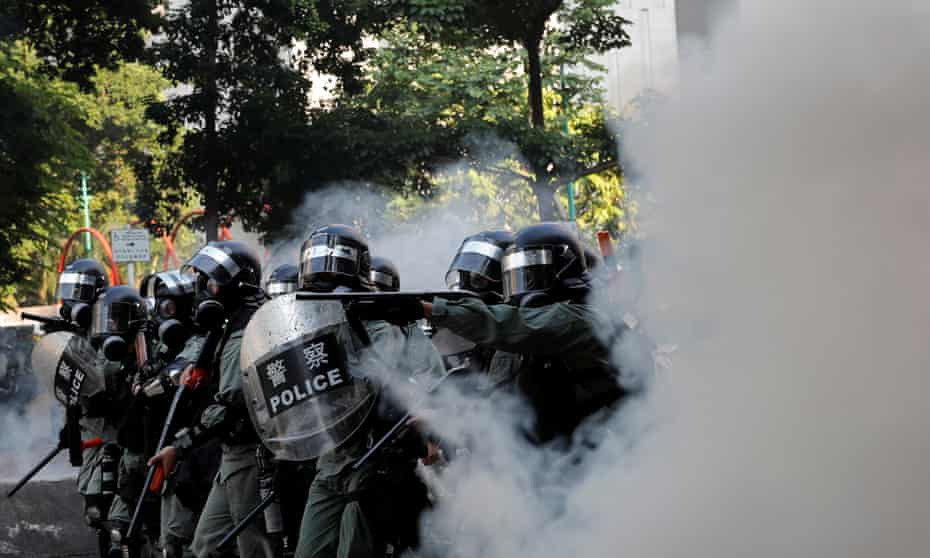 Police fire teargas canisters during a demonstration.